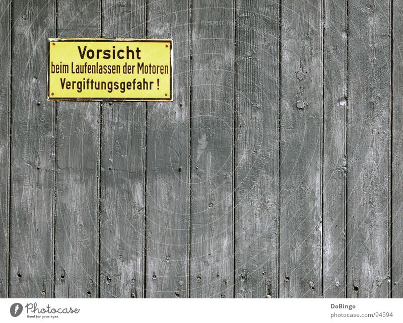 Vorsicht - Erblindungsgefahr gefährlich Motor Wand gelb grau Warnung Holz Alarm achtsam Warnhinweis Warnschild laufender Motor Vergiftung bedrohlich