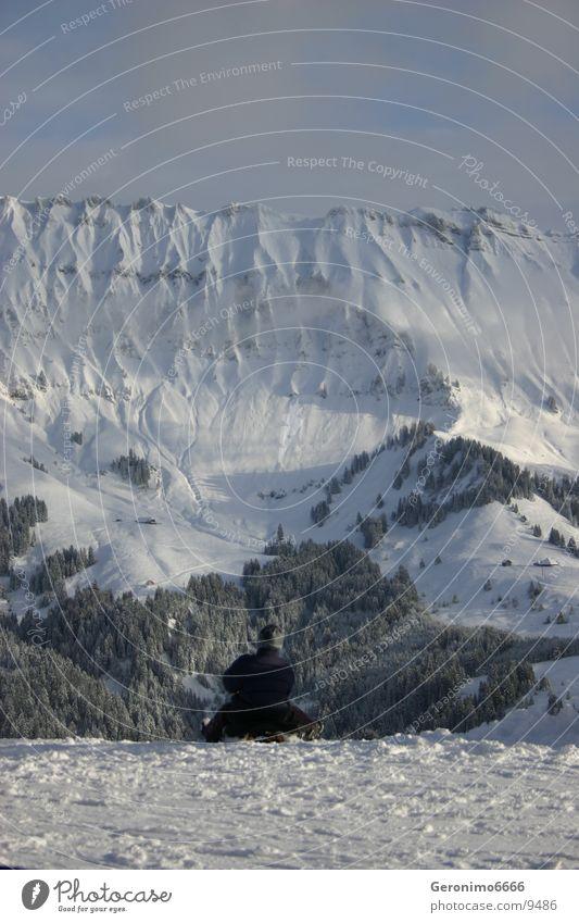 Schlittenfahrt Mann Freude Winter Schnee Berge u. Gebirge Schweiz Schlitten