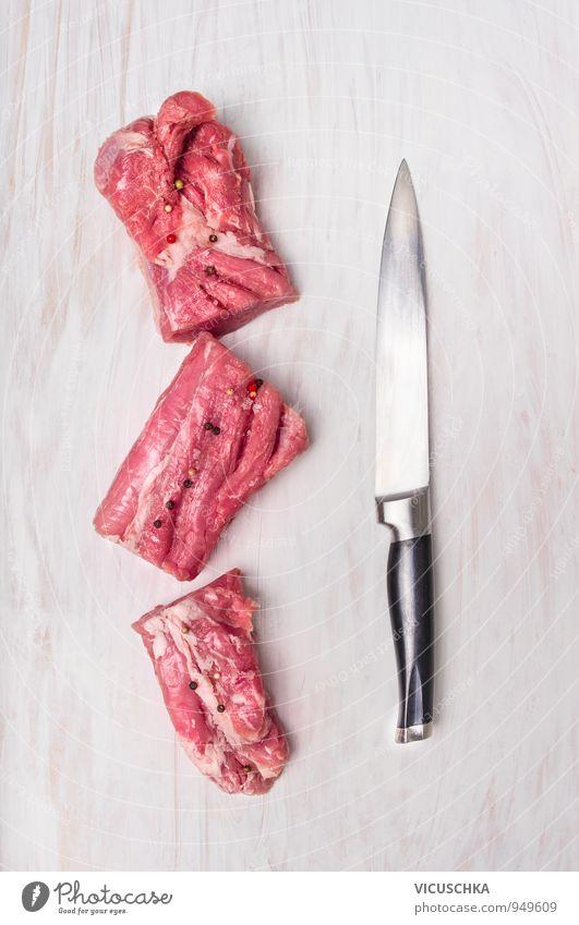 Schweinefilet Stücke mit Fleischmesser weiß rot schwarz Gesunde Ernährung Holz Lebensmittel Metall rosa Lifestyle Freizeit & Hobby Tisch Kochen & Garen & Backen