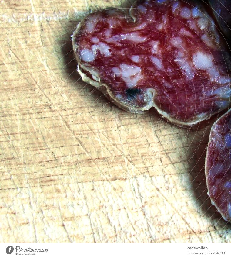 es ist mir sausage Wurstwaren Salami Aperitif lecker Ernährung Gastronomie Fleisch Frankreich banger salamiwurst chopping block hackbrett slices Haarschnitt