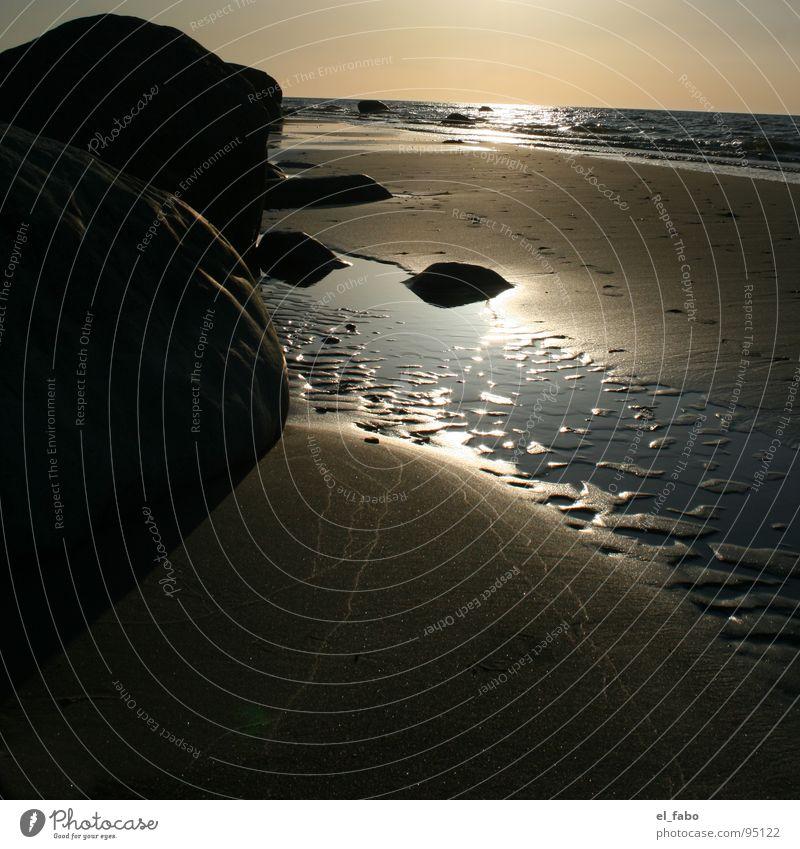 nordstrand Strand Meer Küste Wellen glänzend Licht Sonnenuntergang dunkel Ferien & Urlaub & Reisen Rügen Stein Bruchstück Felsen sommer sonne herzinfakt