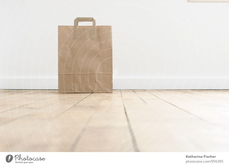 lonely paper bag Verpackung Originalität braun weiß Papier Tüte Behälter u. Gefäße Schließfach Umweltverschmutzung ökologisch Bodenbelag Innenarchitektur