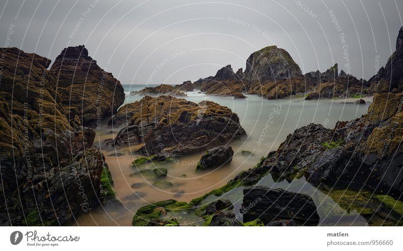 Stein.bruch Natur Landschaft Sand Wasser Himmel Wolken Horizont schlechtes Wetter Moos Felsen Küste Strand Bucht Riff Meer Menschenleer dunkel eckig blau braun