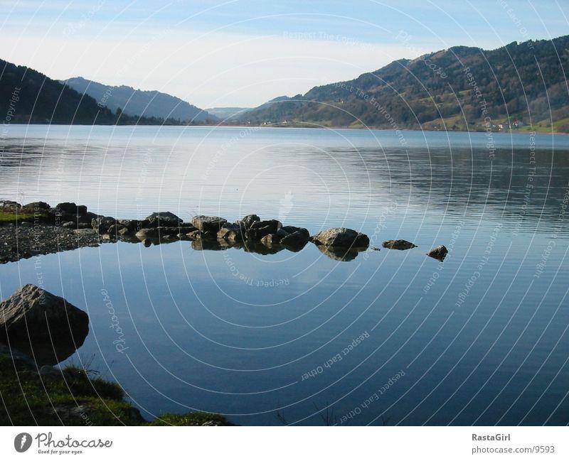 der See II Wasser blau Stein See Küste nass