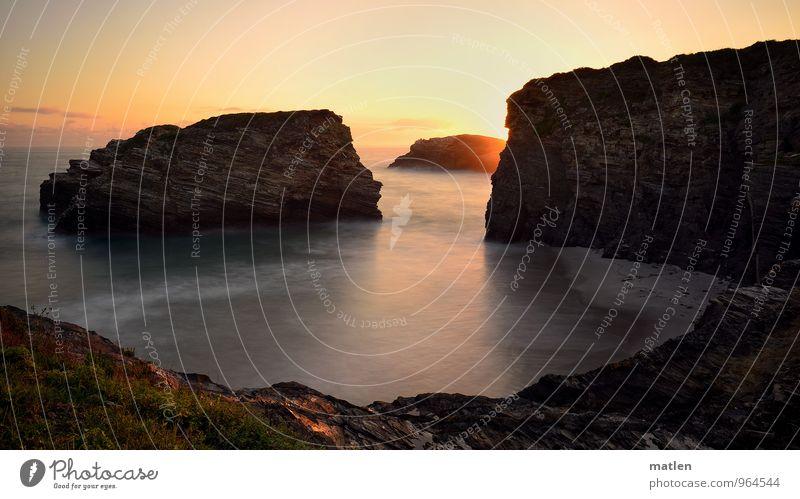 sunrise Himmel blau grün Wasser Meer Landschaft Strand Küste Sand braun Felsen Horizont Wetter orange Wellen leuchten