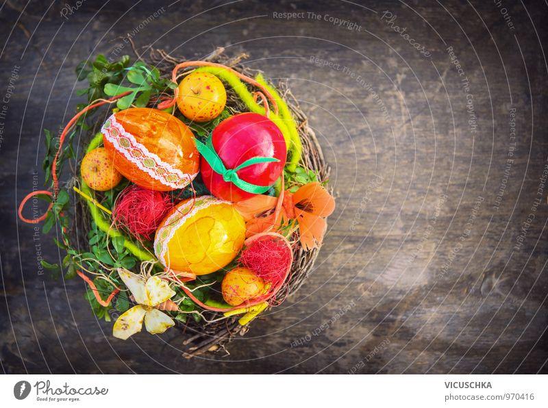 bunte Ostereier mit Schleife in Vogelnest Farbe dunkel Frühling Stil Holz Lebensmittel Lifestyle Freizeit & Hobby Dekoration & Verzierung Design Ostern Spitze