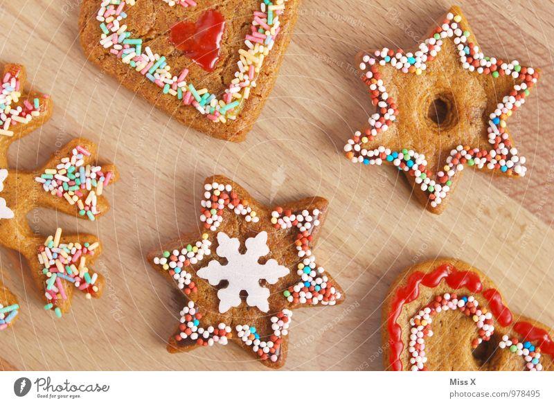 Plätzchen Lebensmittel Teigwaren Backwaren Süßwaren Schokolade Ernährung lecker süß Zuckerstreusel Stern (Symbol) Herz Schneeflocke Streusel Zuckerguß
