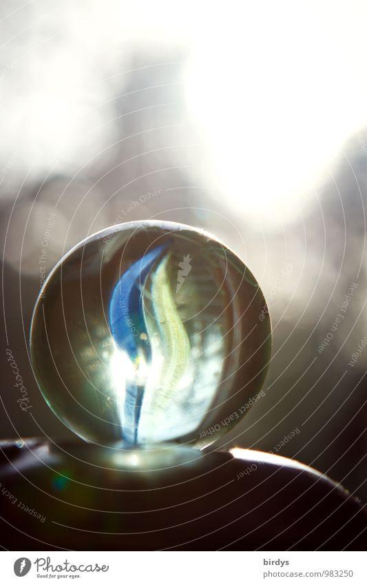 Murmel im Licht Glaskugel glänzend leuchten ästhetisch positiv rund Kindheit durchsichtig Kinderspiel Glücksbringer Unschärfe Farbfoto Innenaufnahme Nahaufnahme