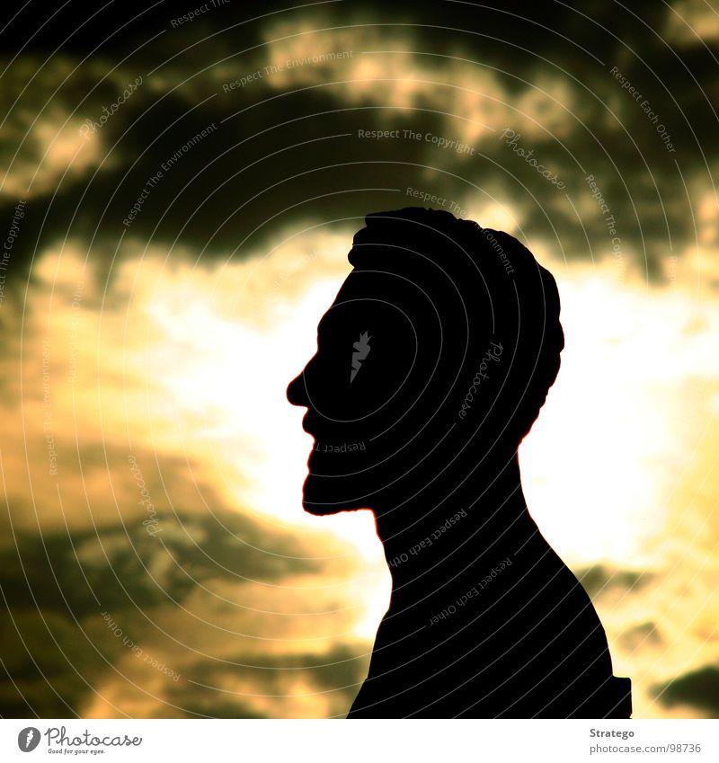 Zuschauer... Silhouette Gegenlicht gelb Wolken schlechtes Wetter Physik Statue Bart Blick bewegungslos schwarz geheimnisvoll fremd ruhig Unendlichkeit