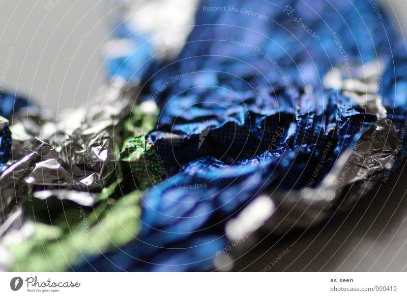 Vernascht Süßwaren Schokolade Reichtum Feste & Feiern Weihnachten & Advent Geburtstag Umwelt Metallfolie Verpackungsmaterial Essen genießen glänzend nah blau