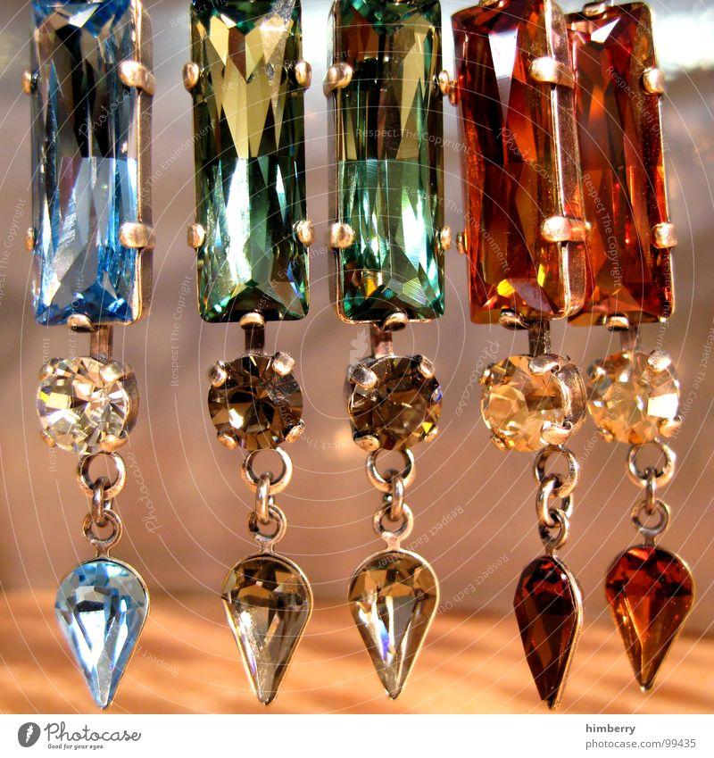 zu verkaufen I Schmuck Edelstein glänzend Accessoire braun rot Handwerk Reichtum Ohrringe Stein Ladengeschäft jewles Glas Reflexion & Spiegelung blau petrol