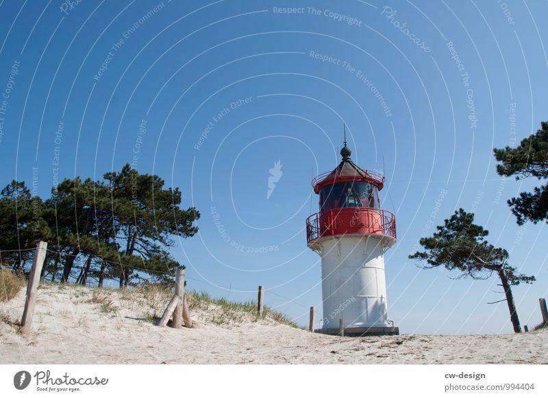 Leuchtturm am Strand Leuchtfeuer Küste Außenaufnahme Himmel Landschaft Farbfoto Natur Ferien & Urlaub & Reisen Tourismus Wolkenloser Himmel wolkenlos